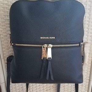 Authentic MIchael Kors backpack(damaged)